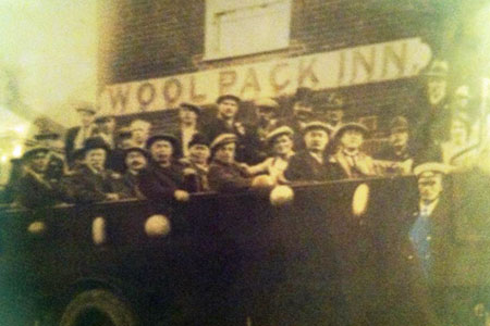 The Woolpack in days gone by - a traditional charabanc outing